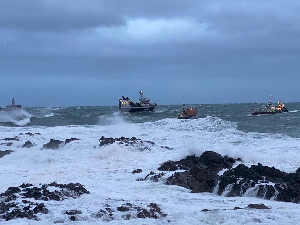 The lifeboat attached a tow to the stricken vessel (left) and towed it to safety (RNLI Peterhead/PA)