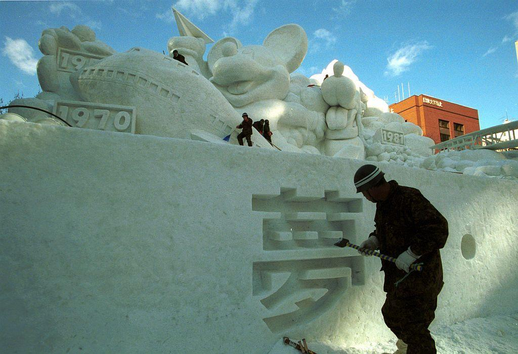 Japan's Ground Self-Defense members create a snow sculpture in preparation for the Snow Festival in Sapporo, northern Japan. About 2.2 million tourists visited the week-long winter festival, which displayed approximately 326 snow and ice sculptures.