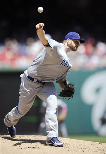 Chicago Cubs starting pitcher Scott Feldman (46) delivers a pitch against the Washington Nationals during the first inning of a National League MLB baseball game Sunday, May 12, 2013, in Washington. (AP Photo/Nick Wass)