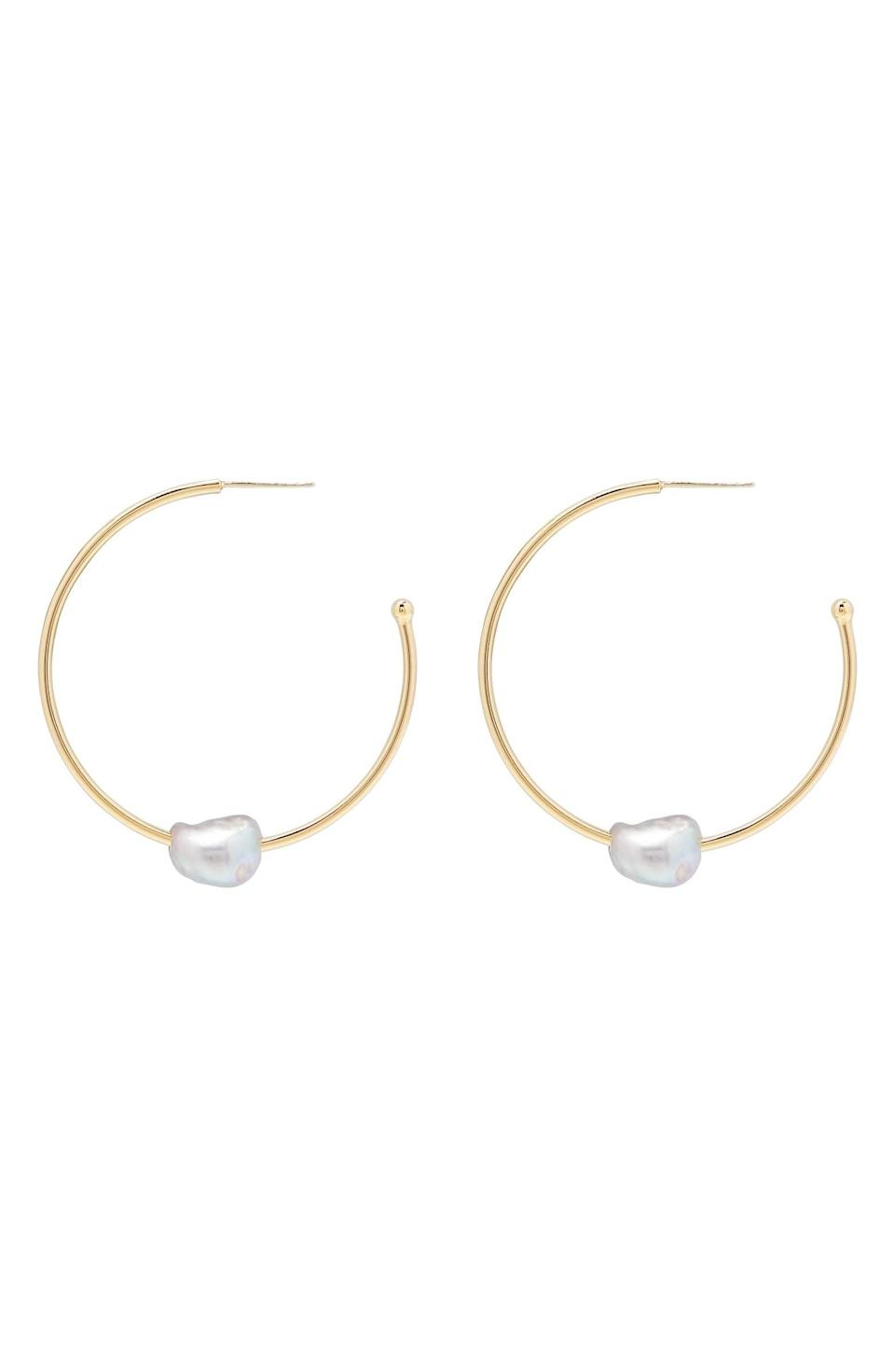 <p><span>Gorjana Perla Imitation Pearl Hoop Earrings</span> ($25, originally $60)</p>