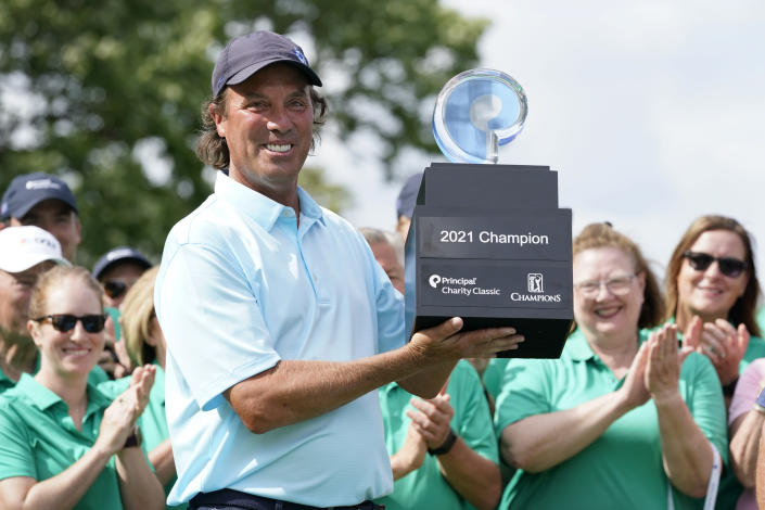 Stephen Ames holds the trophy after winning the PGA Tour Champions Principal Charity Classic golf tournament, Sunday, June 6, 2021, in Des Moines, Iowa. (AP Photo/Charlie Neibergall)
