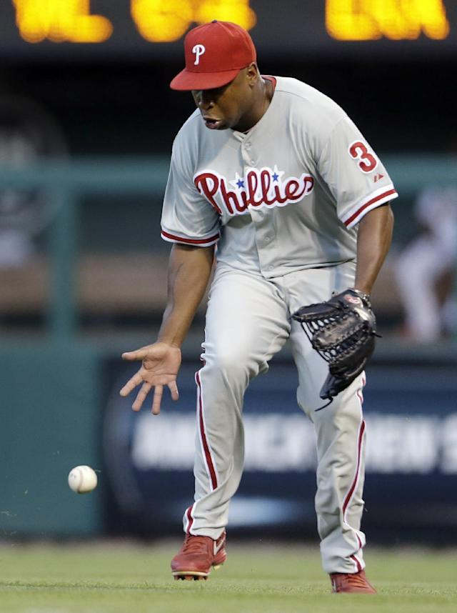 A ball hit by St. Louis Cardinals' Yadier Molina drops in front of Philadelphia Phillies right fielder Delmon Young for an RBI single during the third inning of a baseball game Wednesday, July 24, 2013, in St. Louis. (AP Photo/Jeff Roberson)
