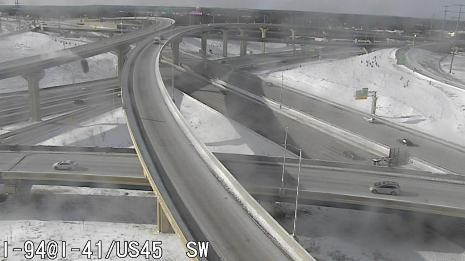 In this Saturday, Feb. 6, 2021 image from video made available by the Wisconsin Department of Transportation, a pickup truck, upper left, falls off an elevated highway in Milwaukee. After plunging about 70 feet (21 meters) off the slippery interchange exit ramp, Richard Lee Oliver said he feels thankful to be alive. (Wisconsin Department of Transportation via AP)
