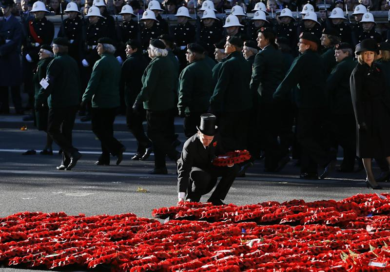 A steward places a wreath during the service of remembrance at the Cenotaph in Whitehall, London, Sunday, Nov. 10, 2013. The annual remembrance service is to remember those who have lost their lives serving in the Armed Forces. (AP Photo/Kirsty Wigglesworth)