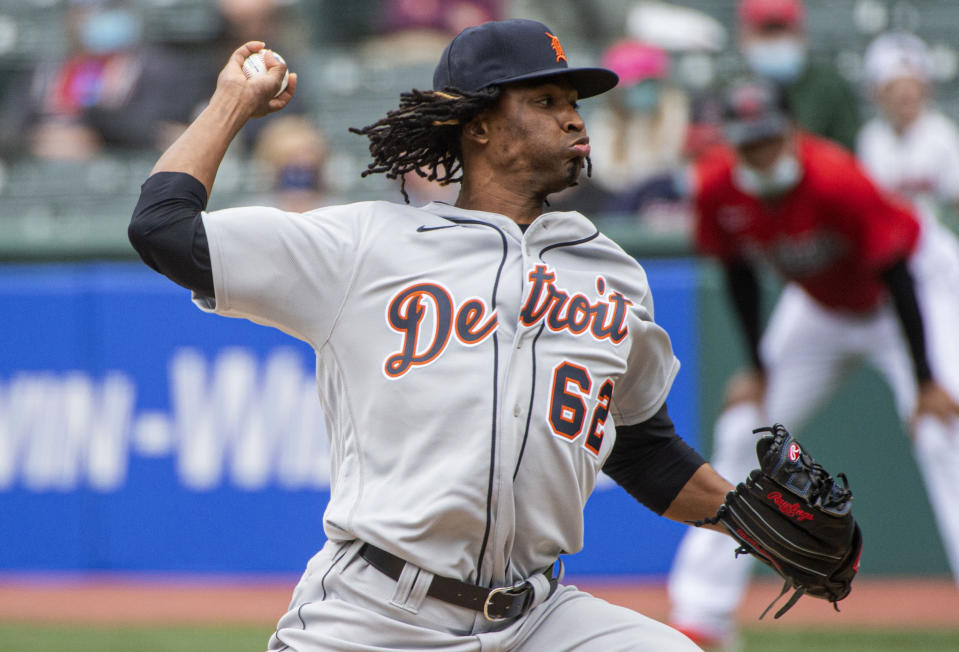 Detroit Tigers starting pitcher Jose Urena delivers against the Cleveland Indians during the first inning of a baseball game in Cleveland, Sunday, April 11, 2021. (AP Photo/Phil Long)