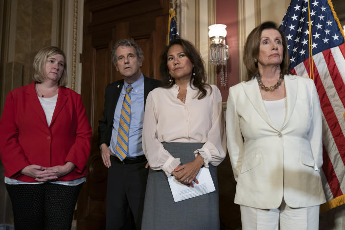 From left, Dayton, Ohio Mayor Nan Whaley whose city suffered a mass shooting Aug. 4, 2019, Sen. Sherrod Brown, D-Ohio, Rep. Veronica Escobar, D-Texas, whose district contains El Paso, Texas, where a gunman killed 22 people at an El Paso, Texas, Walmart, and Speaker of the House Nancy Pelosi, D-Calif., call for a Senate vote on the House-passed Bipartisan Background Checks Act as Congress returns for the fall session with pressure mounting on Senate Majority Leader Mitch McConnell to address gun violence, at the Capitol in Washington, Monday, Sept. 9, 2019. (AP Photo/J. Scott Applewhite)