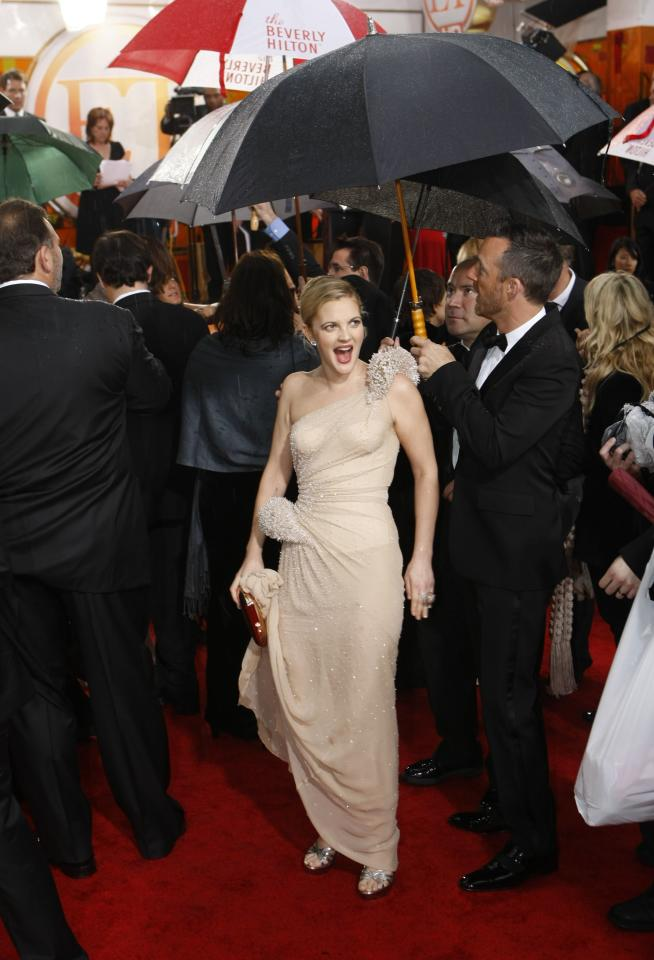 Drew Barrymore, who won her first Golden Globe at the 2010 awards for her role in <em>Grey Gardens</em>, posed pre-show in a sea of umbrellas.