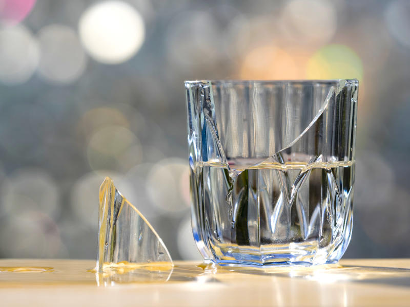 Glass half-empty: it's bad news. Glass half-full: the bad news was expected to be worse. And that's good news in the stock market. (Getty)