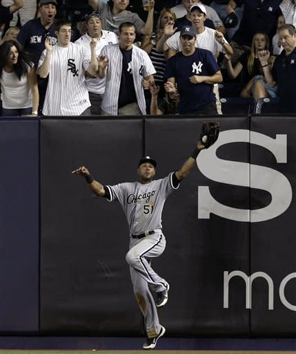Chicago White Sox right fielder Alex Rios, bottom, catches New York Yankees Derek Jeter's ninth-inning fly-out with a man on first for the final out in the White Sox's 4-3 victory in a baseball game at Yankee Stadium in New York, Thursday, June 28, 2012. (AP Photo/Kathy Willens)