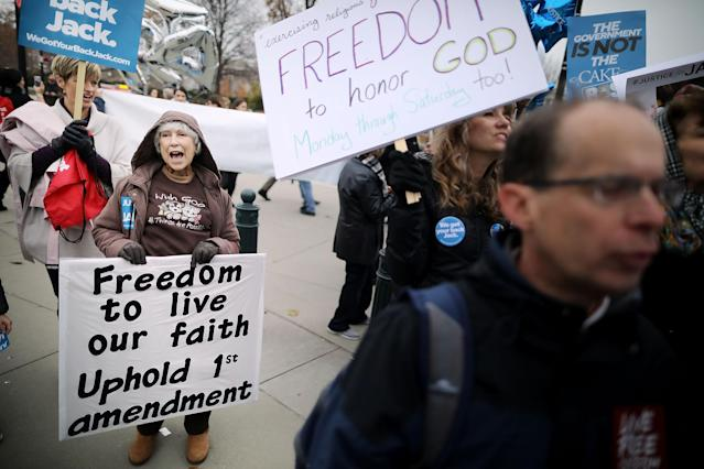 <p>Protesters gather in front of the Supreme Court building on the day the court is to hear the case Masterpiece Cakeshop v. Colorado Civil Rights Commission, Dec. 5, 2017 in Washington. (Photo: Chip Somodevilla/Getty Images) </p>