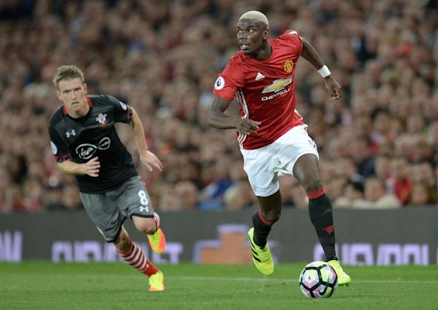 Manchester United manager Jose Mourinho pledged to give Paul Pogba (R) the freedom to play his natural game (AFP Photo/Oli Scarff)
