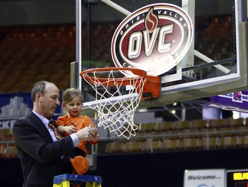 Tennessee Martin head coach Kevin McMillan cuts the net with ihs 3-year-old daughter Alli after the championship game against Tennessee Tech in the Ohio Valley Conference NCAA college basketball tournament on Saturday, March 9, 2013, in Nashville, Tenn. Tennessee Martin won 87-80 in overtime for their third consecutive championship. (AP Photo/Wade Payne)