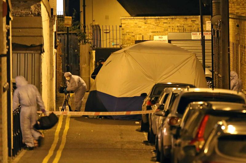 A forensic tent was seen in place at the scene in Hackney: NIGEL HOWARD