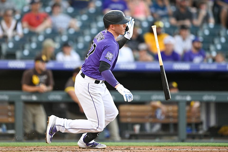 DENVER, CO - JUNE 14: Trevor Story #27 of the Colorado Rockies hits an RBI single in the third inning against the San Diego Padres at Coors Field on June 14, 2021 in Denver, Colorado. (Photo by Dustin Bradford/Getty Images)