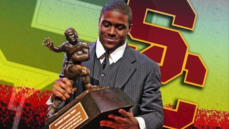 Reggie Bush, as University of Southern California tailback, posing with his 2005 Heisman Trophy, New York, partial graphic