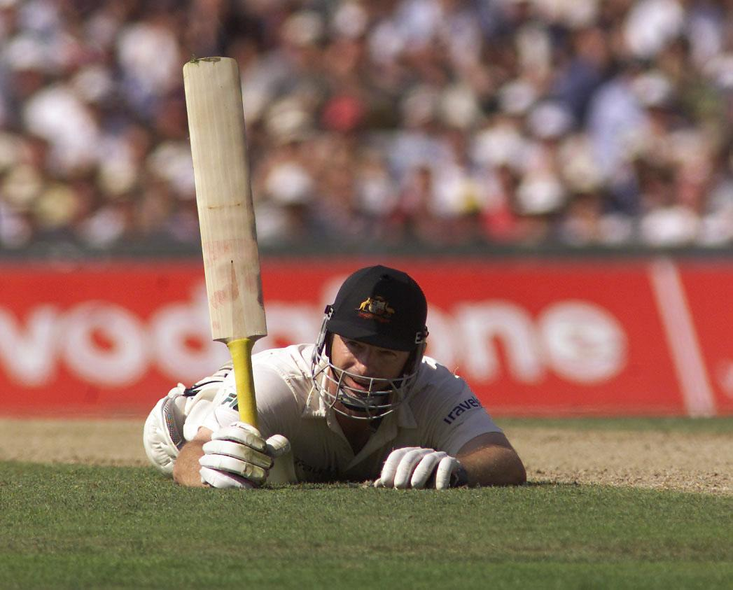 24 Aug 2001:  Steve Waugh of Australia celebrates 100, diving for his ground, during day two of the Fifth Test between England and Australia, at The Oval, London, England.  DIGITAL IMAGE Mandatory Credit: Hamish Blair/ALLSPORT