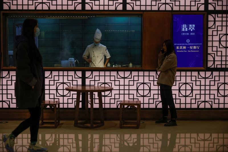 A chef prepares food in a restaurant in a department store following an outbreak of the coronavirus disease (COVID-19) in Beijing