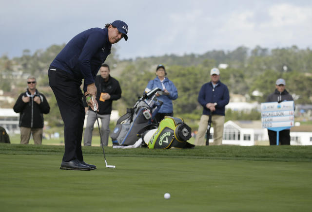 Phil Mickelson misses making an eagle putt on the sixth green of the Pebble Beach Golf Links during the third round of the AT&T Pebble Beach Pro-Am golf tournament Saturday, Feb. 9, 2019, in Pebble Beach, Calif. (AP Photo/Eric Risberg)
