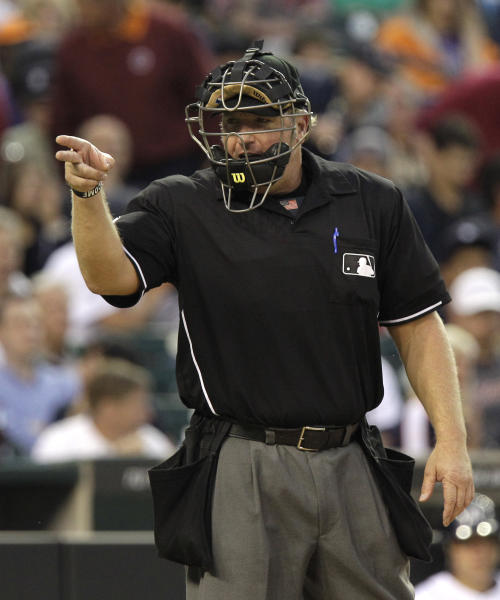FILE - In this June 15, 2011 file photo, homeplate umpire Brian Runge signals during the fourth inning of a baseball game between the Detroit Tigers and the Cleveland Indians in Detroit. Two people familiar with the situation tell The Associated Press that a Major League Baseball umpire was recently dismissed for what was believed to be the first known drug ouster among umps. The two people tell the AP that Runge failed at least one drug test, then reached an agreement so he could remain on the umpire roster. When he failed to comply with those terms, he was released. The people spoke on condition of anonymity because MLB didn't publicly say why Runge was gone.(AP Photo/Carlos Osorio, File)