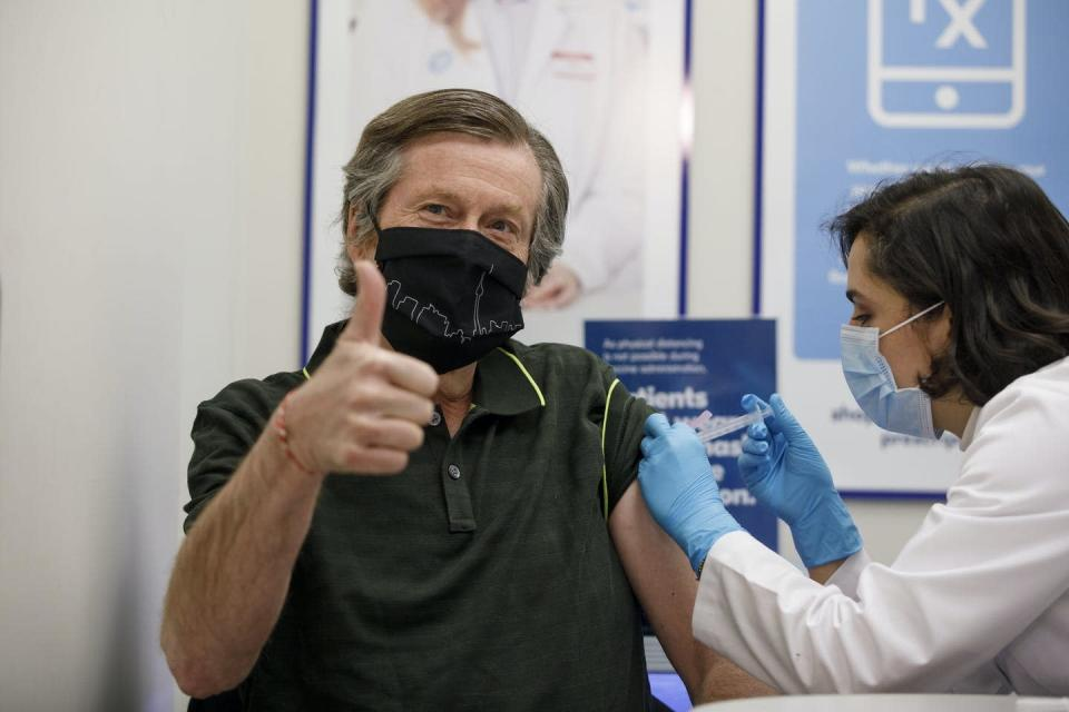 John Tory getting an injection, giving a thumbs-up