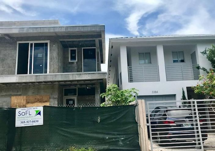 Two houses on the 3300 block of Day Avenue in West Coconut Grove are so close together that only 4 feet, 10 inches of space separate them despite a Miami zoning law that requires 10 feet of setback space. The developer is suing the city of Miami to finish the project; residents want the city to fight the lawsuit and order alteration of the buildings.