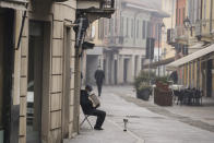 A man plays an accordion in Codogno, northern Italy, Sunday, Feb. 21, 2021. The first case of locally spread COVID-19 in Europe was found in the small town of Codogno, Italy one year ago on February 21st, 2020. The next day the area became a red zone, locked down and cutoff from the rest of Italy with soldiers standing at roadblocks keeping anyone from entering of leaving. (AP Photo/Luca Bruno)