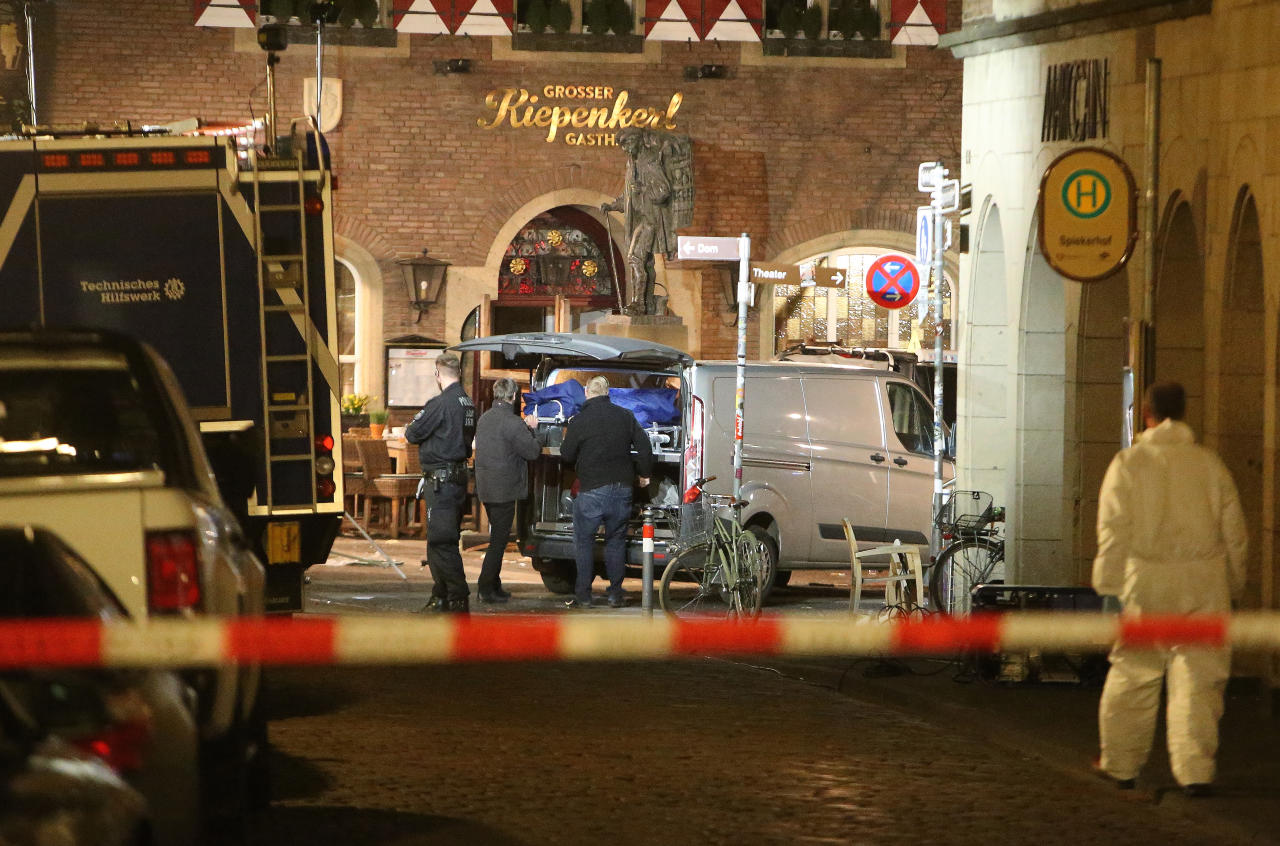 <p>A body is loaded into a vehicle in front of a restaurant in Muenster, Germany, Sunday, April 8, 2018 after a vehicle crashed into a crowd. (Photo: David Young/dpa via AP) </p>