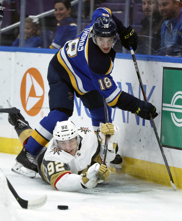 Vegas Golden Knights' Tomas Nosek, of the Czech Republic, and St. Louis Blues' Robert Thomas (18) keep their eyes on the puck along the boards during the first period of an NHL hockey game Thursday, Nov. 1, 2018, in St. Louis. (AP Photo/Jeff Roberson)