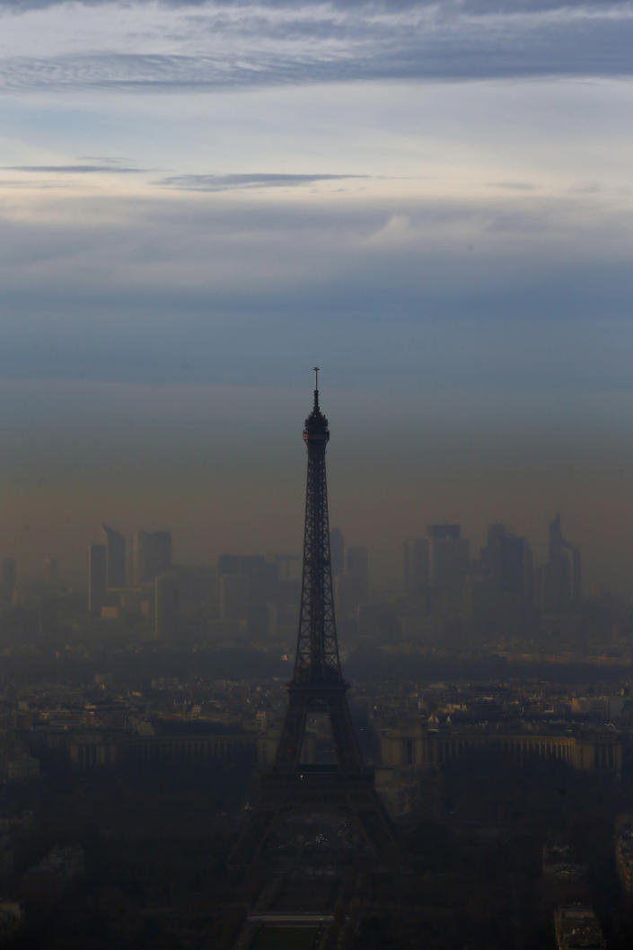 FILE - In this Wednesday, Dec. 7, 2016 file photo, the Eiffel Tower is seen from the Montparnasse Tower, as Paris suffers a pollution spike. The World Health Organization said Wednesday Sept. 22, 2021, the negative health impacts of poor air quality kick in at lower levels than it previously thought, announcing revisions to its guidelines on air quality that set a higher bar for policymakers in a world where 90 percent of people already live in areas with one particularly harmful type of pollutant. (AP Photo/Francois Mori, File)