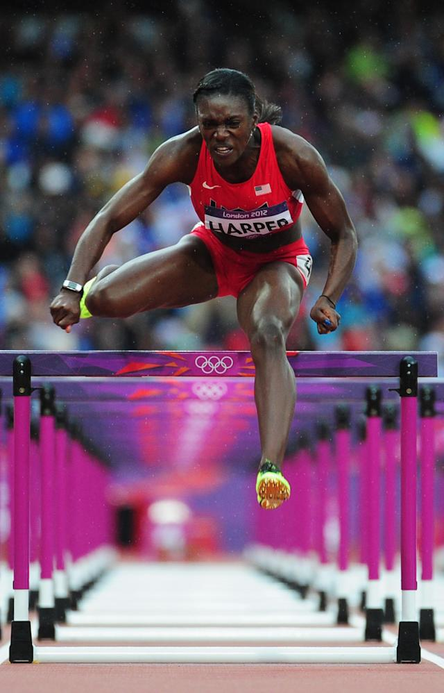 LONDON, ENGLAND - AUGUST 07: Dawn Harper of the United States competes in the Women's 100m Hurdles Semifinals on Day 11 of the London 2012 Olympic Games at Olympic Stadium on August 7, 2012 in London, England. (Photo by Stu Forster/Getty Images)