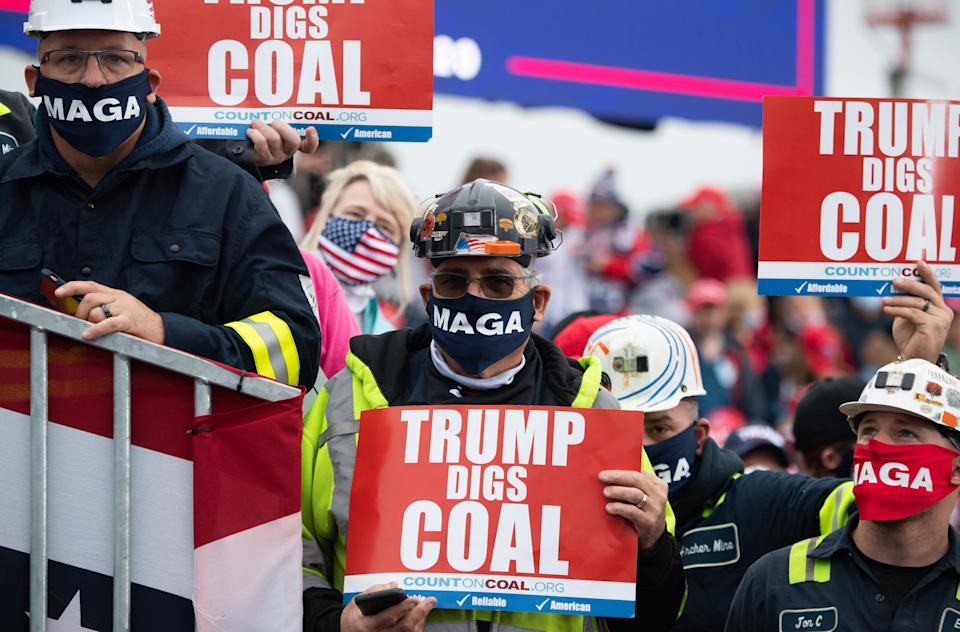 Supporters holds signs in favor of coal mining as US President Donald Trump speaks during a Make America Great Again campaign rally at Altoona-Blair County Airport in Martinsburg, Pennsylvania, October 26, 2020. (Photo by SAUL LOEB / AFP) (Photo by SAUL LOEB/AFP via Getty Images)