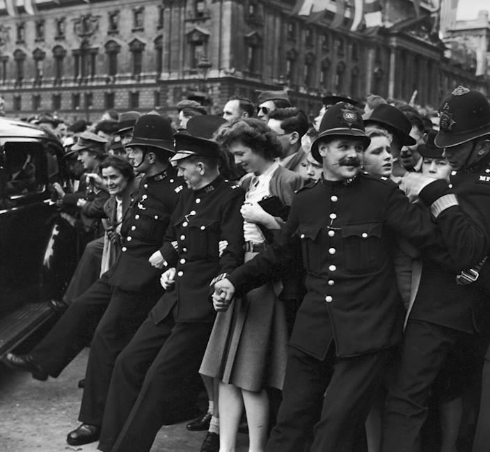 Police struggle to hold back a surging crowd of Londoners massed in Parliament Square on V-E Day, signalling end to WWII in Europe, 8th May 1945. (Photo by Bob Landry//The LIFE Picture Collection via Getty Images)