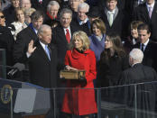 Vice President-elect Joe Biden, with his wife Jill at his side, takes the oath of office from Justice John Paul Stevens, as his wife holds the Bible at the U.S. Capitol in Washington, Tuesday, Jan. 20, 2009. (AP Photo/Elise Amendola)