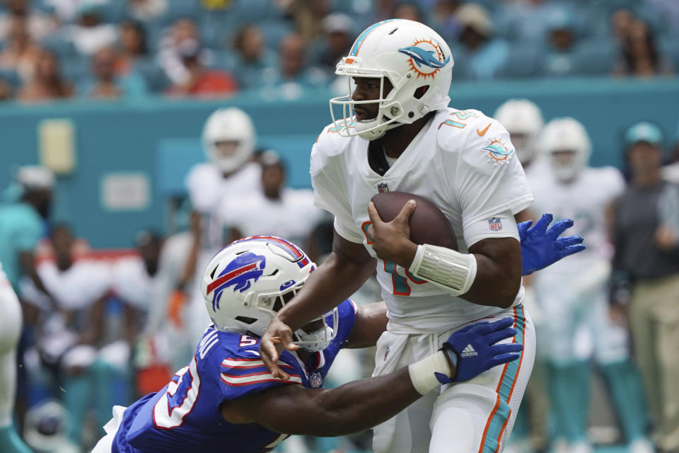 Buffalo Bills defensive end Greg Rousseau (50) pressures Miami Dolphins quarterback Jacoby Brissett (14), during the first half of an NFL football game, Sunday, Sept. 19, 2021, in Miami Gardens, Fla. (AP Photo/Hans Deryk)