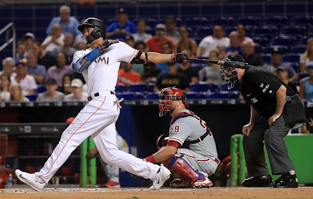 Giancarlo Stanton's impressive pop might not be enough to earn him the NL MVP. (Photo by Mike Ehrmann/Getty Images)