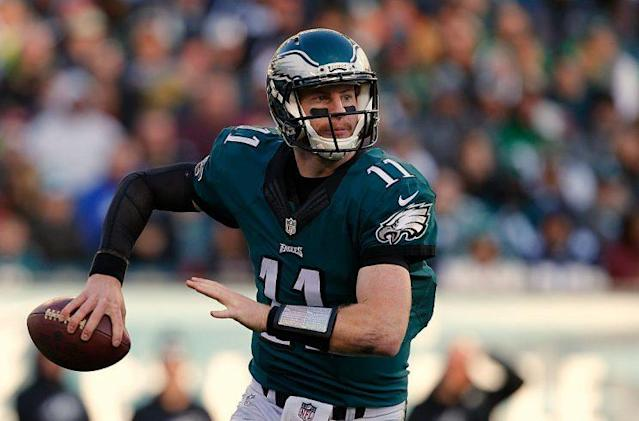 Carson Wentz worked on footwork and mechanics during the offseason, hoping to prove last September wasn't his peak. (Photo by Rich Schultz/Getty Images)