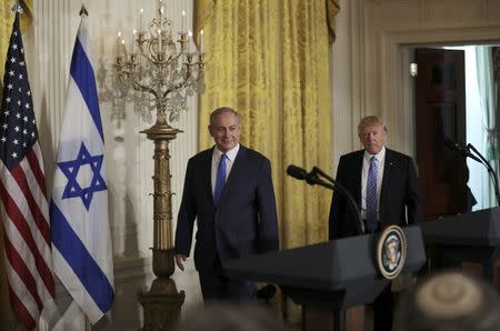 U.S. President Donald Trump (R) and Israeli Prime Minister Benjamin Netanyahu arrive for a joint news conference at the White House in Washington, U.S., February 15, 2017.  REUTERS/Carlos Barria
