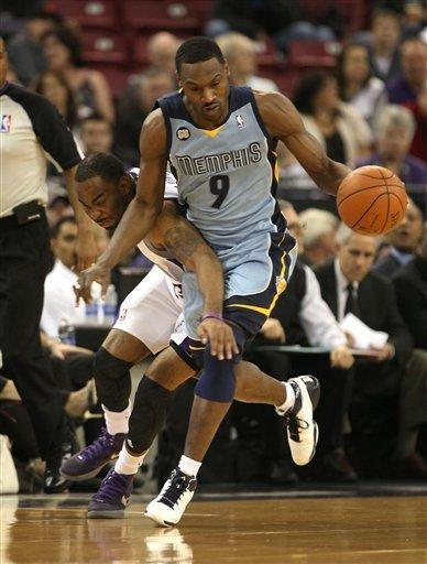 Memphis Grizzlies guard Tony Allen, right, steals the ball from Sacramento Kings guard Marcus Thornton during the first quarter of an NBA basketball game in Sacramento, Calif., Tuesday, March 20, 2012. (AP Photo/Rich Pedroncelli)
