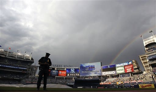 A rainbow is seen over Yankee Stadium as the tarps are removed from the field after a short rain delay before the baseball game between the Tampa Bay Rays and the New York Yankees, Thursday, June 7, 2012, in New York. (AP Photo/Seth Wenig)