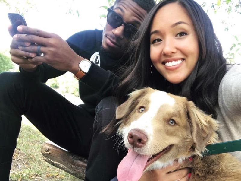 Kerron Johnson is shown with his wife, Gina, and dog Kota. (Photo credit: Johnson family)
