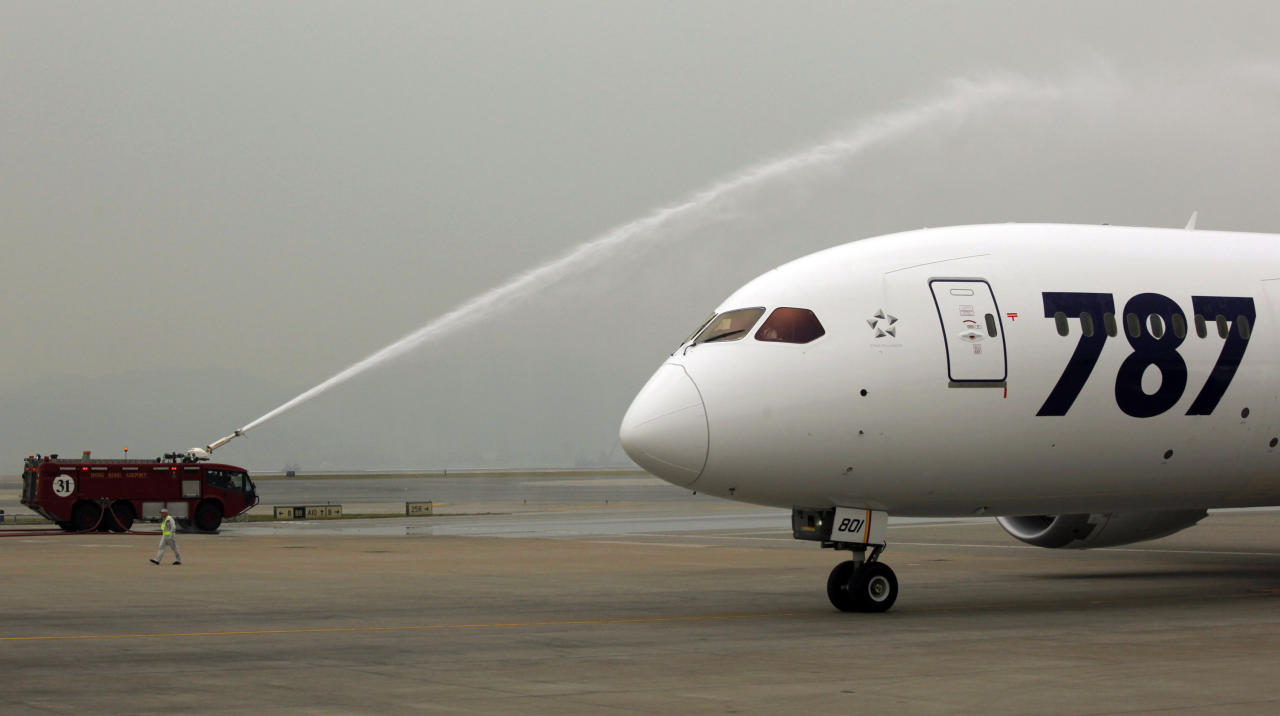 An All Nippon Airways Boeing 787 is sprayed water to celebrate its inaugural commercial flight from Japan, at Hong Kong International Airport on Wednesday, Oct. 26, 2011. The jet, nicknamed The Dreamliner by Boeing Corp., was flown by Japan's All Nippon Airways and was packed with aviation reporters and enthusiasts — some of whom paid thousands of dollars for the privilege. (AP Photo/Vincent Yu)