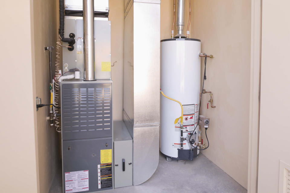 Gas fueled hot water heater and furnace in basement.