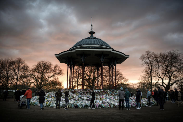 Layers of flowers and messages of support and condolence ring a bandstand, a makeshift memorial to Sarah Everard who authorities say was kidnapped and killed by a police officer, in the London suburb of Clapham, March 17, 2021. (Mary Turner/The New York Times)