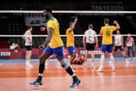 Brazil's Isac Santos celebrates a point during a men's volleyball preliminary round pool B match between Brazil and United States at the 2020 Summer Olympics, Friday, July 30, 2021, in Tokyo, Japan. (AP Photo/Manu Fernandez)