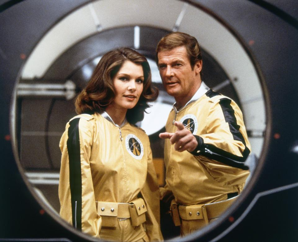 Actor Roger Moore and actress Lois Chiles on the set of