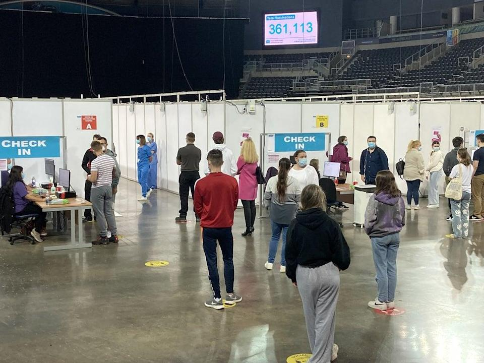 Queues for Covid-19 vaccines at the SSE Arena in Belfast (Rebecca Black/PA) (PA Wire)