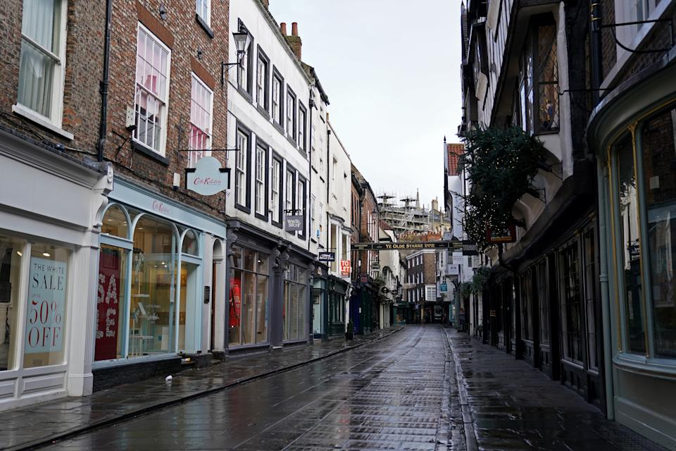 An usually busy street is seen empty in York City Centre. More than three quarters of England's population is being ordered to stay at home to stop the spread of coronavirus. (Photo by Zac Goodwin/PA Images via Getty Images)