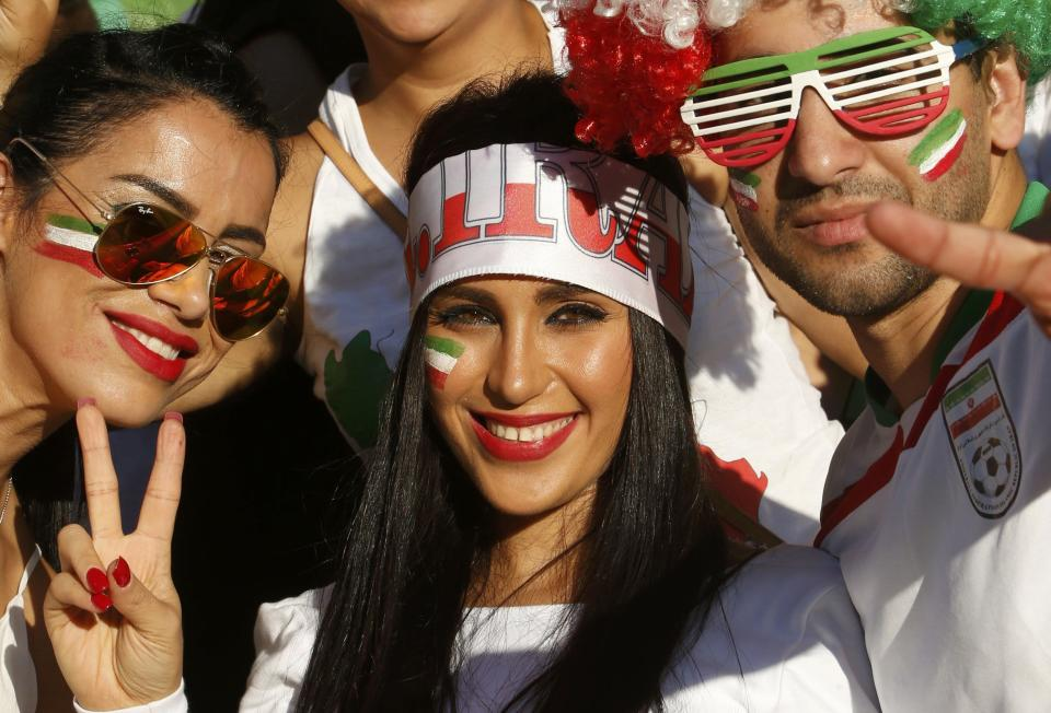 Iran supporters cheer before the Asian Cup Group C soccer match betweeen Iran and Bahrain at the Rectangular stadium in Melbourne January 11, 2015. REUTERS/Brandon Malone (AUSTRALIA - Tags: SOCCER SPORT)