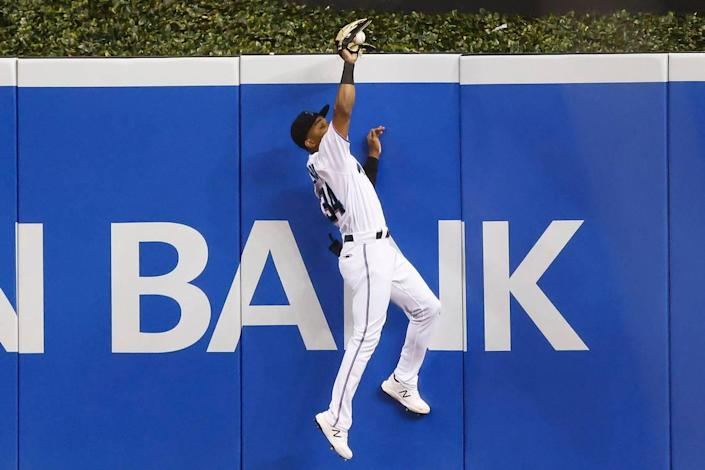 MIAMI, FLORIDA - MAY 06: Magneuris Sierra #34 of the Miami Marlins catches a fly ball hit by Asdrubal Cabrera #14 of the Arizona Diamondbacks during the seventh inning at loanDepot park on May 06, 2021 in Miami, Florida. (Photo by Michael Reaves/Getty Images)