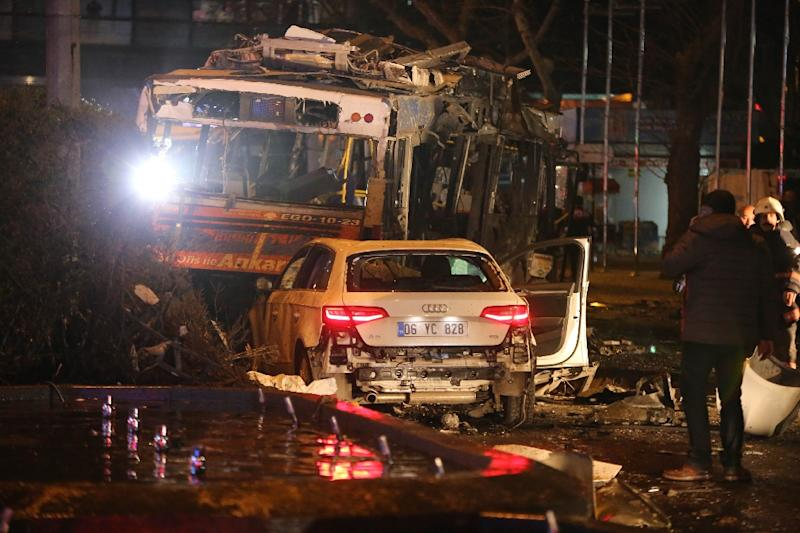 Turkey's interior minister says the suicide car bomb was driven by one or two attackers who deliberately targeted the bus stop in Ankara (AFP Photo/Erol Ucem)